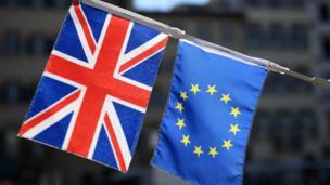 A Union Jack flag n' a EU flag side by side
