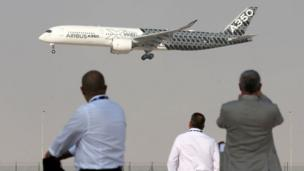 An Airbus A350 performs a flight display during the Dubai Airshow on November 12, 2017,