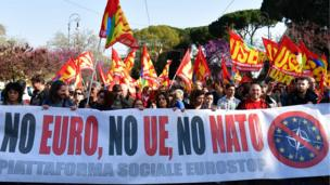 "People take part in a demonstration against the European Union (Euro Stop) on March 25, 2017 in Rome. Italian capital hosts a special summit of European leaders today to mark the 60th anniversary of the bloc""s founding treaties"