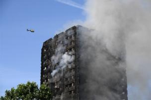 Helicopter circles Grenfell Tower