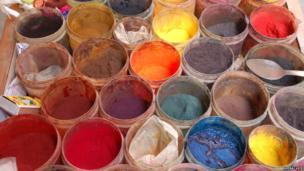 An arrangement of pots containing dyes