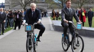 Boris Johnson and Arnold Schwarzenegger on London city hire bicycles