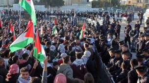 Protesters shout slogans and wave Palestinian flags during a demonstration against the US president's decision to recognise Jerusalem as the capital of Israel, near the American embassy in Amman, on December 8, 2017.