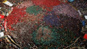 """Castellers de Vilafranca form a human tower called """"castell"""" during a biannual competition in Tarragona city, Spain, October 2, 2016."""