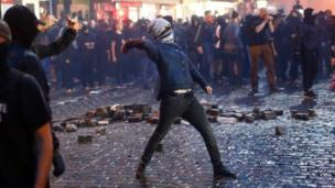 A protester goes to throw something in Hamburg