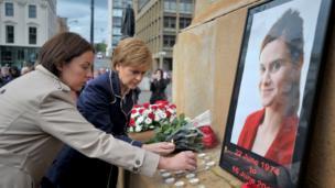 First Minister Nicola Sturgeon (centre) and Scottish Labour leader Kezia Dugdale attend a vigil in George Square