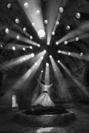 In this photograph which won first place in the People category, F Dilek Uyar captured a Whirling Dervish in the town of Sille, in Konya, Turkey