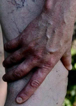 A woman's hand on her leg
