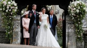 Pippa Middleton and James Matthews pose for photographs after their wedding