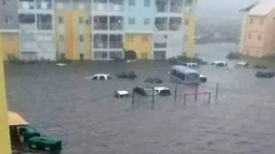 Cars floating outside building