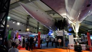 People visit the 'Paris Air Lab' in the Concorde Hall, on June 20, 2017 during the International Paris Air Show