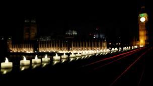 Candles burn on Westminster Bridge, Thursday evening.
