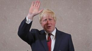 Boris Johnson waves as he announces he will not run for Conservative Party leader