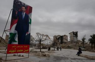 Poster-poster raksasa Presiden Assad dipasang di mana-mana sejak pasukan Suriah merebut kembali Aleppo. Kemenangan pasukannya di sini membawa perang ke tahap baru kata wartawan kami.