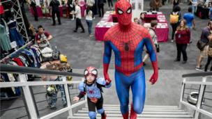 Father and daughter dressed up as Spiderman