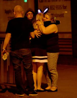 Concertgoers consoled each other at the scene outside the Manchester Arena.