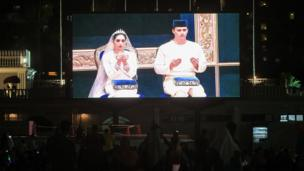 The wedding ceremony is projected on a giant screen for public viewing at Dataran Bandaraya (city square) in Johor Bahru
