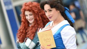 Disney fans in princess costumes at the D23 Expo in California
