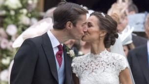 James Matthews and Pippa Middleton kiss after their marriage