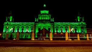 Belfast City Hall in Northern Ireland glowed green ahead of a day of celebrations in the city