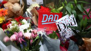 Father's Day cards are among the tributes left for victims of the fire