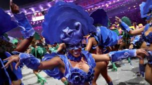Woman in blue costume dances as part of the opening ceremony in Rio (5 August 2016)