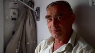 Meet Boris. Boris is a military veteran from Satka, a town that sits near the geographical divide between Europe and Asia. His young grandson is going to school for the first time in a town a few hours away, and Boris wants to be there to see it. The 67-year-old now works as head of occupational safety and health at his company.
