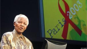 Mandela gives a speech 14 July 2003 in Paris during the second day of an AIDS four-day conference.