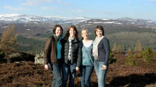 Friends posing for a photo on Creag Choinnich