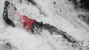 Person coming down a waterfall
