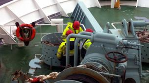 Workers on a ferry