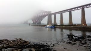 Boat moored near the Forth Bridge