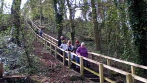 People walking through woodland