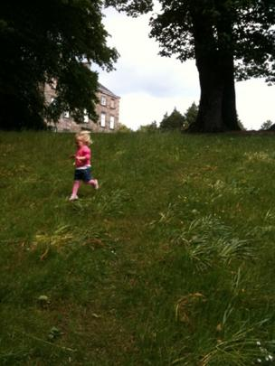 Ella running down a hill