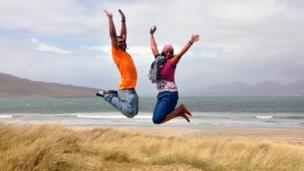 Srinath and Deepa jumping in the air