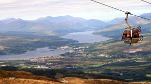 Mountain bikes in a cable car over Fort William