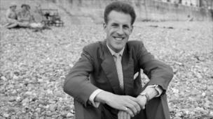 Bruce Forsyth on a beach in 1958