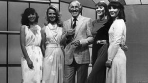 """Sir Bruce Forsyth seen here with the four female hostesses, or """"Dolly Dealers"""" of """"Play Your Cards Right""""; Denny Kemp, Natalie Shaw, Jo Thomas and Yvonne Younger."""