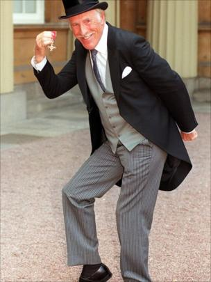 Bruce Forsyth collecting his OBE