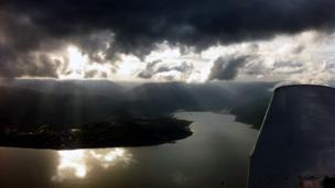 Piper PA28 Warrior aircraft over the Holy Loch