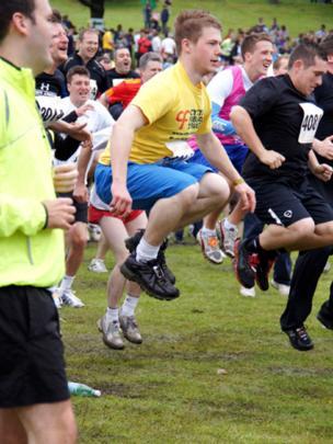 Men preparing for the start of a 10k run