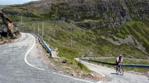 Betsy cycling up Bealach na Ba Road
