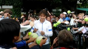 Nadal in the grounds signing hi autograph