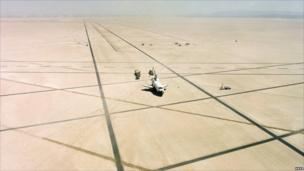 Space Shuttle Columbia rests on Rogers Dry lake bed at Edwards Air Force Base, California, after landing and completing its first orbital mission