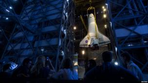 The space shuttle Atlantis STS-135 is hoisted to the high bay for mating to the external tank and solid rocket boosters inside the vehicle assembly building at the Kennedy Space Center, 18 May 2011.