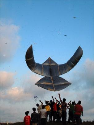 People flying Javanese traditional kite