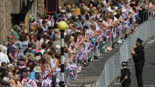 A huge crowd lining the streets to support royal couple