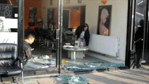 Damage to a hair salon after rioting in Tottenham, north London