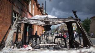 Tottenham High Road viewed through the shell of a car