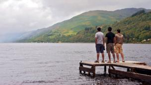 Satish, Bachi and Ampolu looking at Loch Earn from the pier